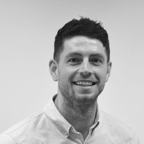 black and white portrait photo of adam stephens