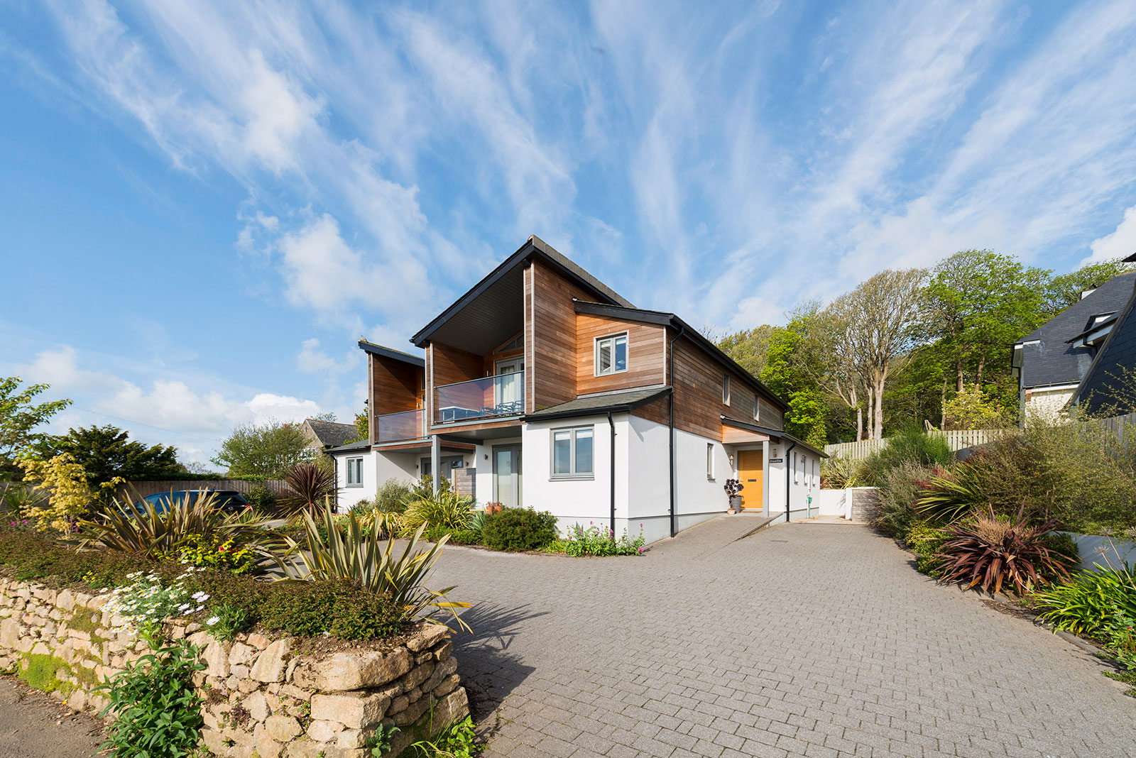 contemporary glazed riverfront homes in lelant, cornwall