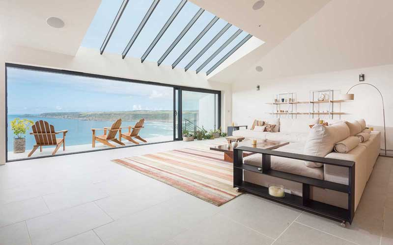 contemporary reverse living coastal house in sennen cornwall with balconies and incredible sea views on steep cliff